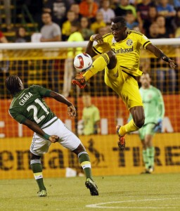 Columbus Crew midfielder Tony Tchani (6) kicks the ball away from Portland Timbers midfielder Diego Chara (21) in the first half of their game at Mapfre Stadium in Columbus, Ohio on September 26, 2015. (Columbus Dispatch photo by Brooke LaValley)